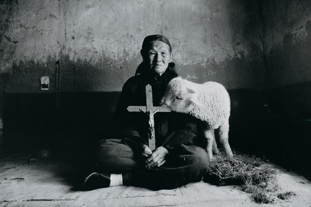 Lu Nan, Old Woman Holding Cross, with Lamb, Shaanxi, 1992