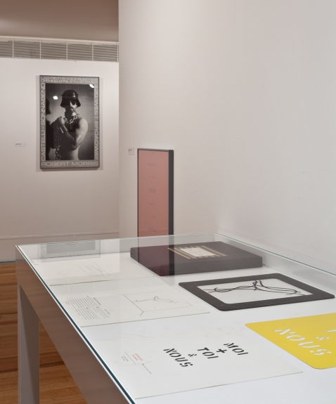 """View of the exhibition """"An Infinite Conversation"""" with editions by Robert Morris, Bruce Nauman, Sol Lewitt, Jessica Diamond and Lawrence Weiner. Museu Coleção Berardo, 2014."""